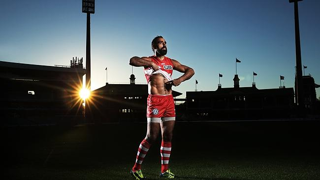 This year marks 20 years since St. Kilda's Nicky Winmar took a stance against racism in the AFL. One of the great Indigenous players to of all time, Adam Goodes of the Sydney Swans reenacts the moment. The Swans play Collingwood on Friday night kicking off the AFL's Indigenous Round.